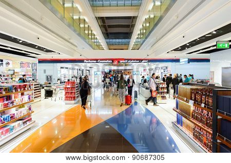 DUBAI - MARCH 10, 2015: Dubai duty-free shopping area interior. Dubai International Airport is the primary airport serving Dubai and is the world's busiest airport by international passenger traffic