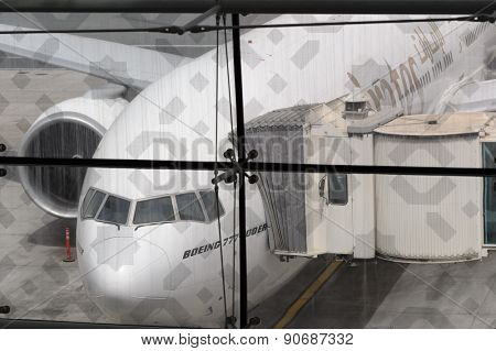 DUBAI, UAE - MARCH 10, 2015: Airbus A380 docked in Dubai airport. Dubai International Airport is an international airport serving Dubai. It is a major airline hub in the Middle East