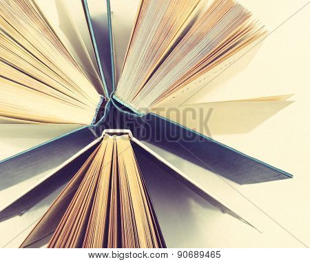 Group of books on light background, top view