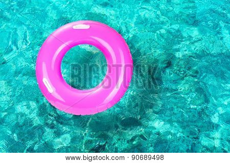 Lifebuoy on water background