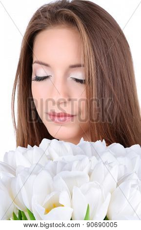 Beautiful young woman holding white flowers isolated on white