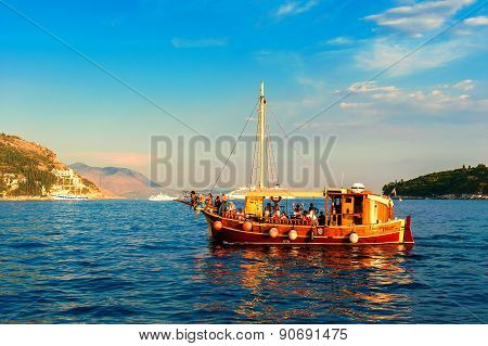 Dubrovnik, Croatia - August 28: Tourists Riding In An Old Ship In The Adriatic Sea Near Dubrovnik At