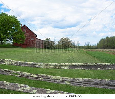 rural farm viewed through fence
