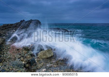 Wave Crashing On A Rock At Table Rock Beach, In Laguna Beach, California.