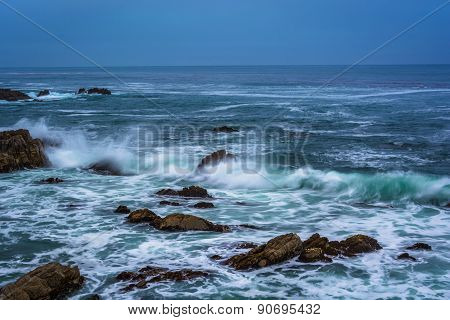 Waves Crashing On Rocks In The Pacific Ocean At Twilight, In Pacific Grove, California.