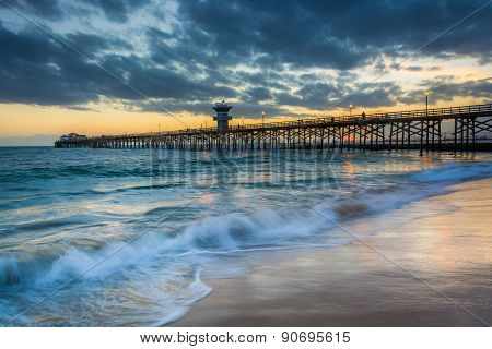 Waves In The Pacific Ocean And The Pier At Sunset, In Seal Beach, California.