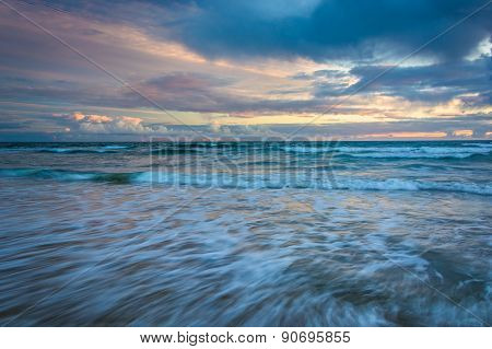 Waves In The Pacific Ocean At Sunset, In Newport Beach, California