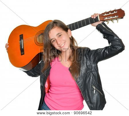 Trendy hispanic teenage girl carrying a guitar over her shoulders isolated on white