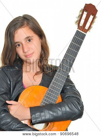Beautiful hispanic teenage girl hugging her acoustic guitar isolated on white