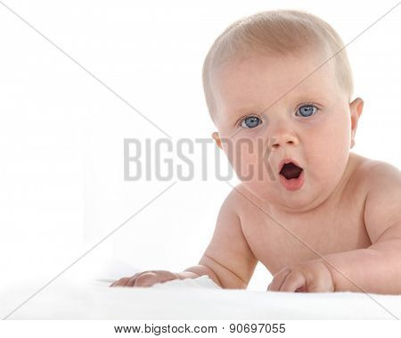 baby lying down on white blanket isolated on white studio shot looking at camera caucasian