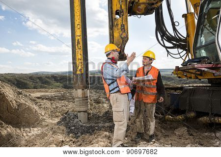 Engineer Directs Construction Worker