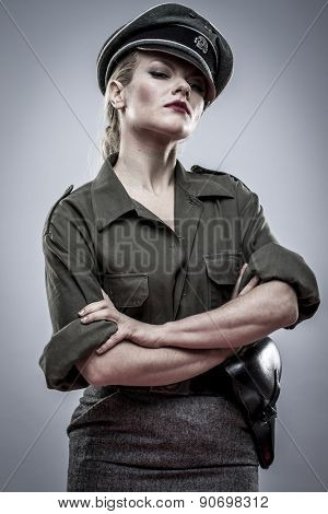 Dominatrix, German officer in World War II, reenactment, soldier beautiful woman
