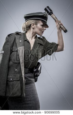 Grenade. German officer in World War II, reenactment, soldier beautiful woman