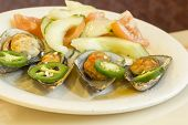 foto of jalapeno  - Spicy chili mussels with jalapeno slices and cucumber tomato salad - JPG