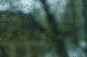 picture of raindrops  - Raindrops on the window with blurred background - JPG