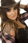 stock photo of cowgirl  - A cowgirl up close with her tattoo on her shoulder showing - JPG