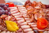 pic of smoked ham  - Choice of smoked ham and sausages on the table - JPG