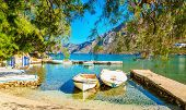 foto of greek-island  - Peaceful haven with boats in sea bay of Greek island - JPG