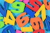 picture of blue things  - Colorful plastic numbers on a blue background - JPG