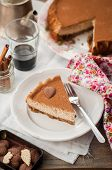 pic of cheesecake  - A Slice of Spiced Coffee Cheesecake Dusted with Cocoa Powder copy space for your text - JPG