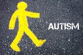 pic of pedestrians  - Yellow pedestrian figure on the road walking towards AUTISM - JPG