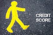 picture of pedestrians  - Yellow pedestrian figure on the road walking towards CREDIT SCORE - JPG