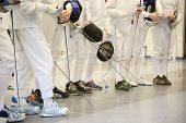 stock photo of rapier  - fencer with fencing mask and rapier - JPG