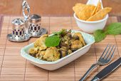 foto of curry chicken  - stew chicken in curry with mushrooms on wooden table - JPG