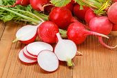 pic of wooden crate  - Macro of fresh sliced red radish in wooden crate - JPG