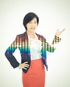 pic of polite girl  - Pretty Asian reporter is posing a presentation gesture in white background with colorful abstract light effect on her body - JPG