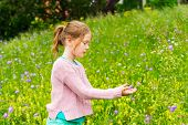 stock photo of pullovers  - Cute little girl playing in a park - JPG