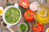 stock photo of pesto sauce  - sauce of pesto near a tomato olive oil and eggs in a studio - JPG