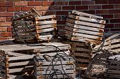 stock photo of lobster  - Antique crab traps and lobster traps outside the lighthouse keepers quarters at Cape Florida Lighthouse - JPG