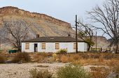 picture of power lines  - Abandoned building by the railroad tracks in the book cliff mountain range. Includes power poles, power lines and trees. ** Note: Soft Focus at 100%, best at smaller sizes - JPG