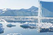 pic of iceberg  - Beautiful Icebergs in Disko Bay Greenland around Ilulissat with blue sky - JPG