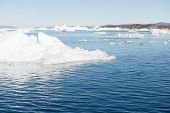 stock photo of iceberg  - Beautiful Landscape in Greenland with mountains Icebergs and blue Sky - JPG