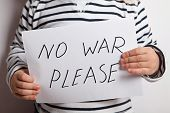 pic of war terror  - No war text written on paper held by a child - JPG