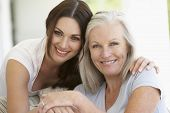 picture of grown up  - Mature Mother And Daughter Hugging - JPG