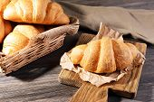stock photo of croissant  - Delicious croissants on table close - JPG