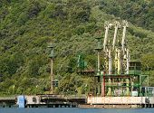 pic of fuel pump  - Gas and oil pump plant in sea shore - JPG