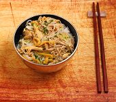 picture of rice noodles  - Vietnamese vermicelli chicken and rice noodles soup pho on a wood table top - JPG