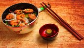 image of rice noodles  - Vietnamese shrimp and rice noodles soup pho served on a wood table top - JPG