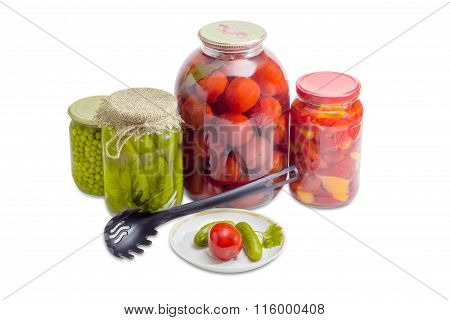Pickled Vegetables On Saucer And In Glass Jars