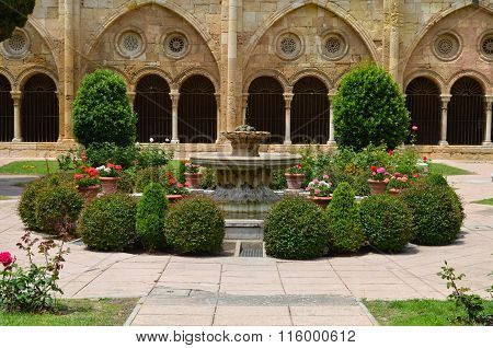 in the monastery courtyard with a fountain