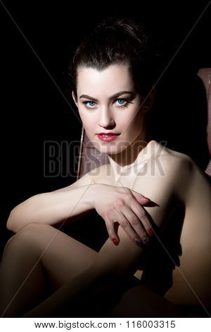 Nude model posing looking as femme fatale