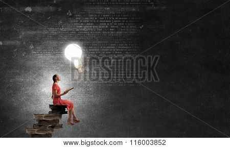 Attractive girl reading book
