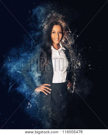 Beautiful business woman looking confident with hands on hips, surrounded by light flares and smoke