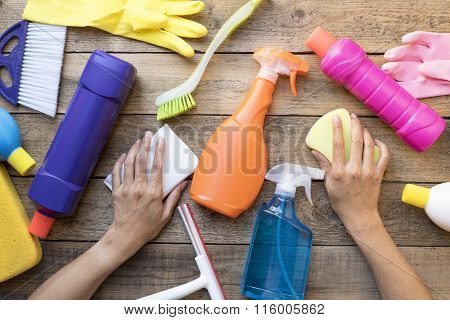 Women Prepare To Clean House On Wood Table