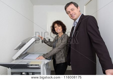 Attractive Successful Business Partners With A  Man And Woman Posing Back To Back With Folded Arms S