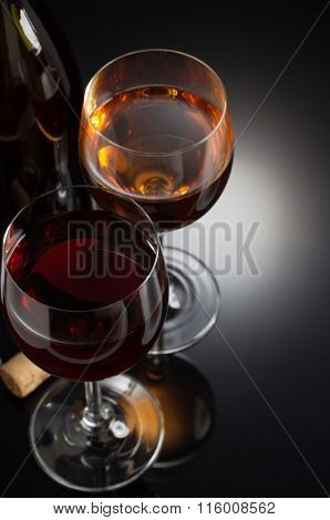 wine and wineglass on black background